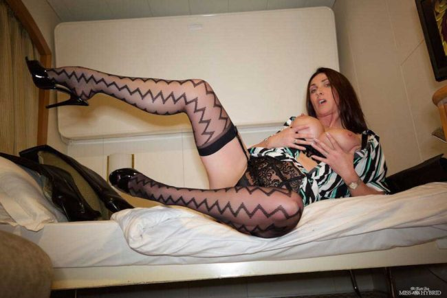 Miss Hybrid sexy stockings and lingerie, legs open in her cabin.